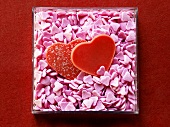 Red chocolate hearts and pink sugar hearts in box