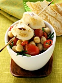 Barbecued calamares on chick pea and tomato salad