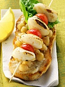 Cuttlefish & cherry tomato kebab on bread with chick peas