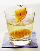 Cocktail with orange and ice cubes