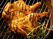 Whole chicken (opened out) on barbecue rack