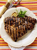 Barbecued lamb steak on plate