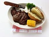 Boneless ribeye steak with baked potato & sour cream