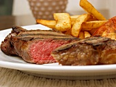 Medium sirloin steak with chips