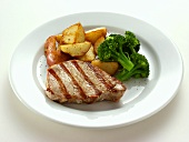 Pork steak with broccoli and fried potatoes