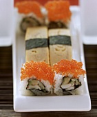 Nigiri sushi with egg custard & Maki sushi with salmon caviare