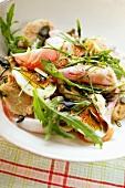 Salad with bread dumplings, ham, egg and rocket