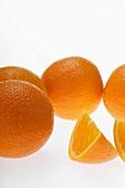 Oranges and wedge of orange