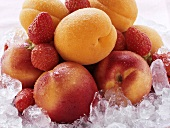 Apricots, nectarines and strawberries on crushed ice