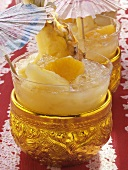 Thai sangria with pineapple in golden bowl