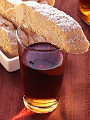 Italian almond biscuits (cantucci) on glass of Vin Santo