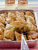 Baklava in aluminium dish with cake slice