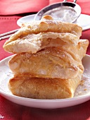 Puff pastries with apple filling and icing sugar