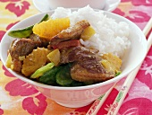 Roast duck with mangetouts, orange and rice