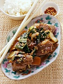 Duck with chard and sesame; mixed spices; rice