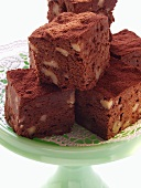 Brownies with walnuts on green cake plate
