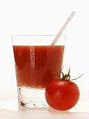 Tomato juice in glass with straw; cherry tomato