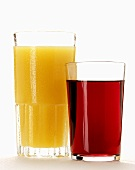 Orange juice and red grape juice in glasses