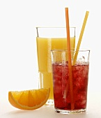 Orange juice; red grape juice with ice cubes; orange wedge