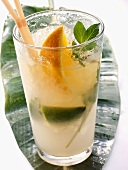 Caipirinha with lime, wedge of orange and mint