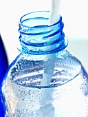 Mineral water bottle with straw
