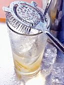 Bar strainer on glass with drink