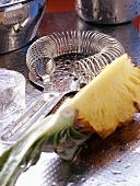 Bar strainer and fresh pineapple