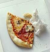 Pizza remains with napkin in cardboard box