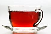 Hot hibiscus tea in glass cup