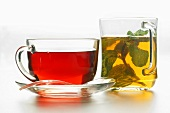 Hibiscus tea and peppermint tea in glass cups