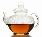 Hot fruit tea in glass teapot