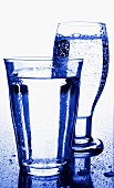 Two glasses of mineral water in blue