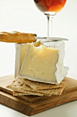 Saint Andre triple cream cheese with crackers and cheese knife