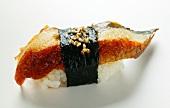 Nigiri sushi with fried mackerel, nori and sesame