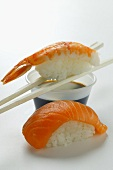 Sushi with salmon and shrimp; soy sauce
