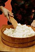 Stirring sushi rice