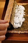 Preparing rolled sushi