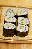 Maki-sushi with cucumber on wicker tray