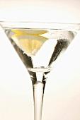 Martini with wedge of lemon