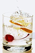 Slice of lemon falling into a drink