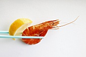Shrimp with lemon on chopsticks