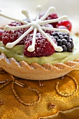 Berry tartlets with pistachio cream and chocolate star