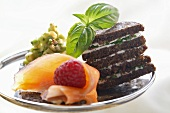 Pumpernickel snacks with salmon, soft cheese and avocado