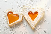 Sweet pastry hearts with apricot jam and icing sugar