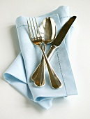 Cutlery on blue napkin