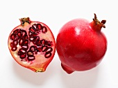 Whole and half pomegranate