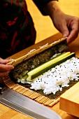 Preparing rolled maki-sushi
