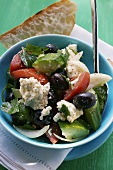 Greek salad with white bread
