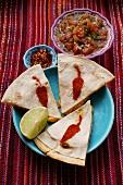 Shrimp enchiladas; tomato salsa; chili flakes
