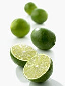 Limes, one halved